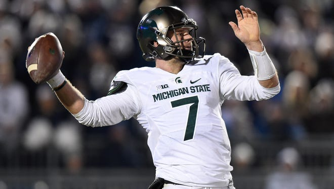 Michigan State quarterback Tyler O'Connor (7) passes the ball against during the third quarter of MSU's 45-12 loss Saturday in State College, Pa.