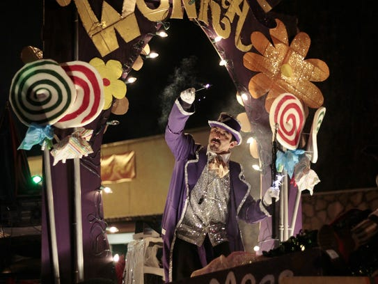 Wily Wonka waves to the crowd lining Sudderth Drive