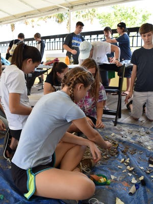 Students in Loggerhead Marinelife Center's Marine Science Academy sort marine debris collected during the Jan. 21 beach cleanup in Juno Beach.