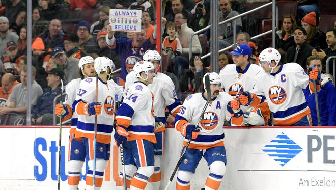 The Islanders celebrate a goal against the Philadelphia Flyers during the second period at Wells Fargo Center.