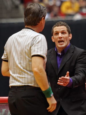 Northern Iowa wrestling coach Doug Schwab and the Panthers squad face rival Iowa State Sunday.