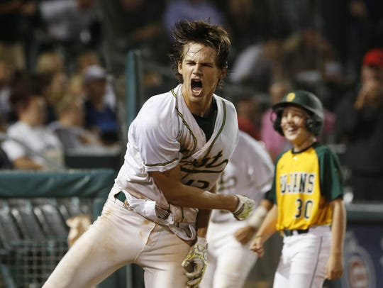 Iowa City West's Tanner Lohaus celebrates their win