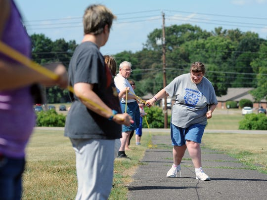 Jessca Freeman, of Zanesville, makes her way down the 50 assisted walk course during last year's practice at Starlight School in Zanesville in preparation for the Special Olympics. This year's Special Olympics track and field meet was canceled due to the COVID-19 pandemic.
