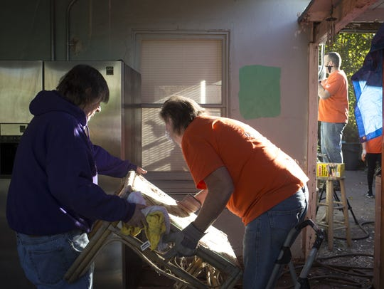 Rick Introne (center, Home Depot volunteer) works with