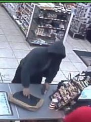 The robber had a bag that he placed on the counter.