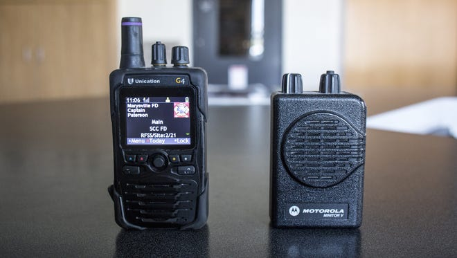 A digital pager is seen next to an analog pager at the Marysville Fire Department.