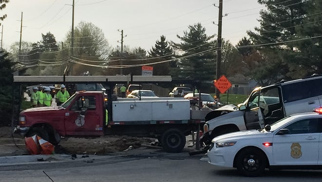 Several construction workers were injured Tuesday when a vehicle crashed into a work zone near 82nd Street and Hague Road.