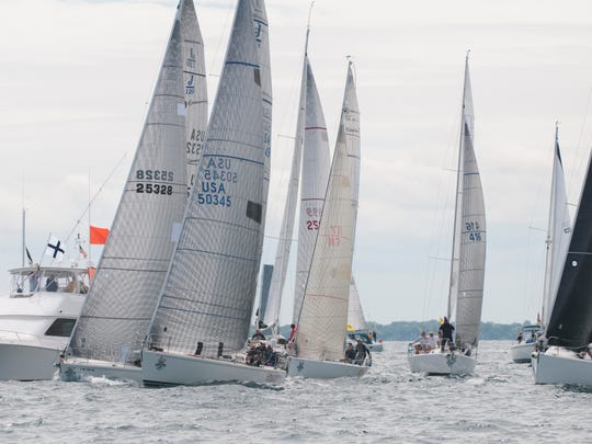 To get the best start Hot Ticket, Ihnsanity Too, Vanguard, Say Uncle and Windshadow sail extremely close to the race committee boat as the boats start in the fifth start Saturday, July 16, 2016 during the start of the Port Huron-to-Mackinac Island Sailboat Race.