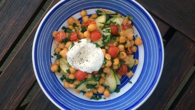 Skillet chickpeas, packed with veggies, is a complete (and quick) meal when served over rice or quinoa.