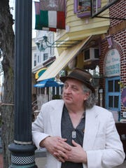 Luigi Vitrone, owner of Pastabilities in Wilmington's Little Italy, stands along Lincoln Street in that section of the city in 2012.