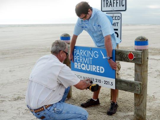 Billy Carlton (left), beach maintenance foreman, and