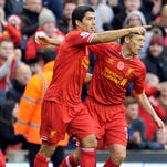 Liverpool defeated Fulham 4-0 behind two goals by Luis Suarez.