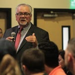 Assistant provost of regional campuses Jeffrey Jones stands up from the crowd to respond to a student inquiring about curriculum cuts at the start of the student open forum. .