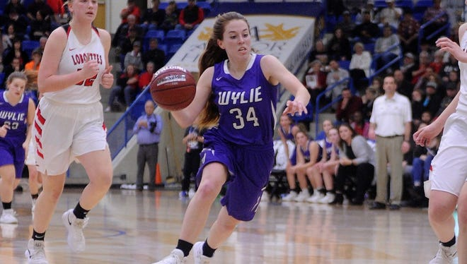 Wylie senior guard Julia Lovelace (34) drives the lane during the Region I-4A semifinal against Levelland at the Rip Griffin Center in Lubbock on Friday, Feb. 23, 2018.