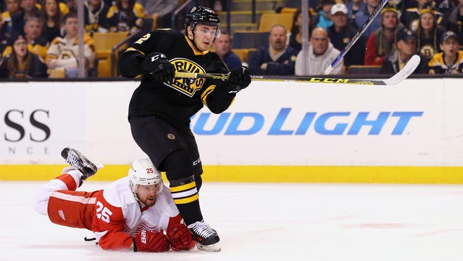 Mike Green dives to try to stop Frank Vatrano during the Red Wings' loss to the Bruins Saturday night.