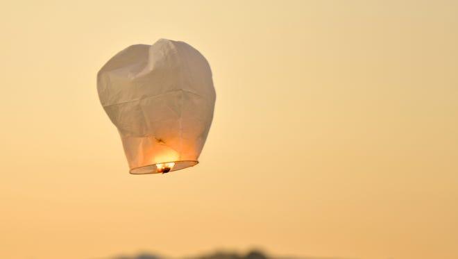 Sky lantern fly at sunset