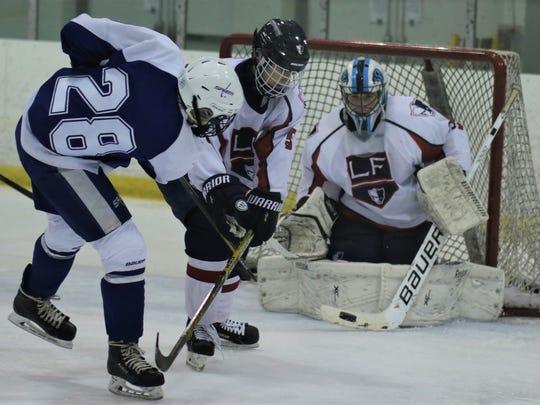 Livonia Franklin goalie Jacob Penny turns away a shot