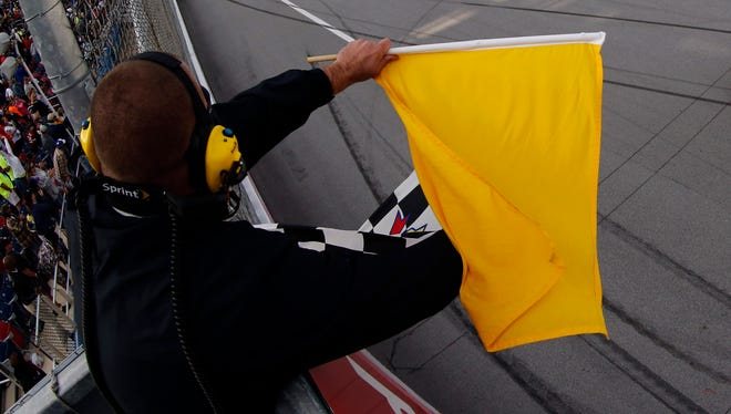 Warning flag at NASCAR Sprint Cup auto race at Talladega Superspeedway on Sunday, Oct. 7, 2012.