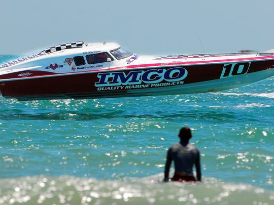 The IMCO No. 10 powers its way over rough water as a spectator gets a closeup view during a previous powerboat race in Cocoa Beach.