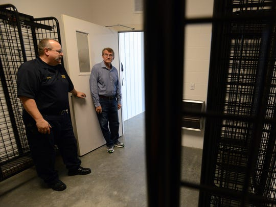 Bloom Township Fire Chief Terry Gill, left, and Fiscal Officer Dave Cyphert talk as they tour the department's new fire station Tuesday in Bloom Township. The room is used to keep firefighter's gear in a separate room with its own ventilation system. The new station on Lithopolis Road opens Saturday and will be the department's second station.