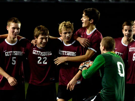 Gettysburg 's Drew Wivell (22) celebrates his goal with this teammates Zach Shoemaker (5), Adam Yingling (2) and Yanni Tassou (0) in the first half of the PIAA District 3 semifinal against Elco at Hersheypark Stadium. Gettysburg lead 2-0 at the half on Monday, October 27, 2014. Jeremy Long -- GametimePA.com