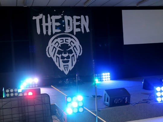 The lights on the stage of the new inner city community center, The Den, pulsate with the beat of the music.