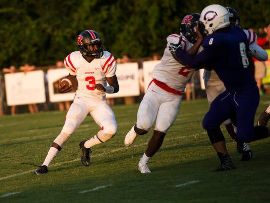 Rossview's Isaiah Phillips runs with the ball during