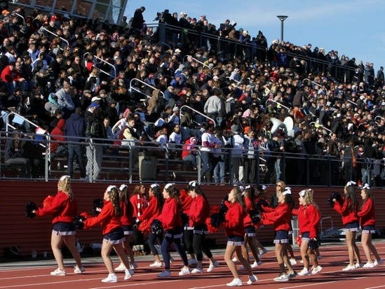 The Stepinac cheerleaders entertain the crowd during the annual Turkey Bowl at White Plains High School Nov. 24, 2011. Stepinac won the game 38-14.