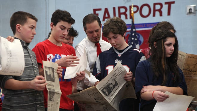 In this file photo, students and facility celebrate the 50th Anniversary of Martha Brown Middle School in Fairport with the opening of a time capsule that was in the corner stone of the building.