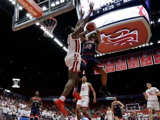Arizona guard Allonzo Trier (35) shoots against Washington State forward Robert Franks (3) during the first half of an NCAA college basketball game in Pullman, Wash., Wednesday, Jan. 31, 2018. (AP Photo/Young Kwak)