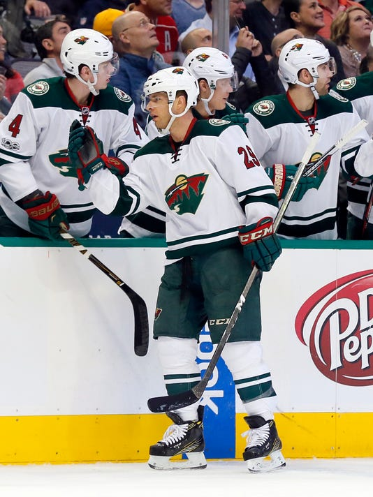 Minnesota Wild right wing Jason Pominville (29) celebrates with the bench after scoring against the Dallas Stars in the first period of an NHL hockey game in Dallas, Tuesday Jan. 24, 2017. (AP Photo/Tony Gutierrez)