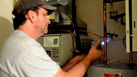 If your heater's not leaking or rusting or exploding, a good tuneup or repair might allow you to delay purchasing a replacement for another few years, especially if yours is relatively new.