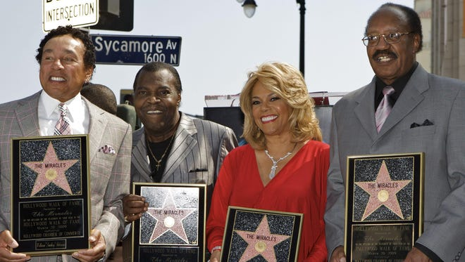 """Warren """"Pete"""" Moore, second from left,  Moore died Sunday. He, along with William """"Smokey"""" Robinson, far left, Claudette Robinson and Robert """"Bobby"""" Rogers of the famed Motown group The Miracles received a star on the Hollywood Walk of Fame in Los Angeles on March 20, 2009."""