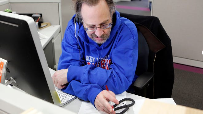 CPA Steve Shinder of Shinder and Shinder in Nanuet helps a caller during a tax hotline session at The Journal News office, March 1 in White Plains,