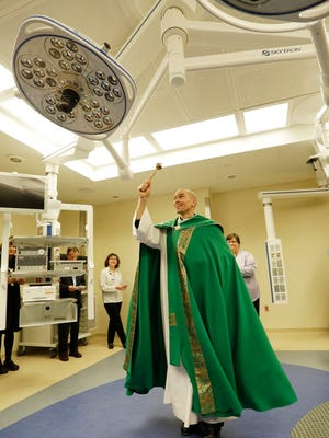 Rev. Matthew Widder blesses one of the new operating rooms at HSHS St. Nicholas Hospital Thursday February 23, 2017 in Sheboygan.  The hospital built five new operating rooms to update aging facilities.