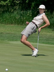 Maggie Leef tries a little body english on a putt during a tournament in 2005.