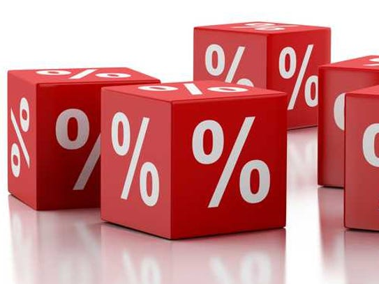 Red dice with percentage signs on them.