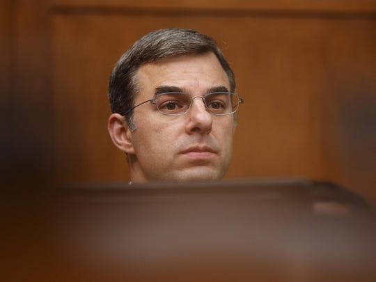"House Oversight and Reform National Security subcommittee member Rep. Justin Amash, R-Mich., looks out from the dais on Capitol Hill in Washington, Wednesday, May 22, 2019, during the House Oversight and Reform National Security subcommittee hearing on ""Securing U.S. Election Infrastructure and Protecting Political Discourse."""