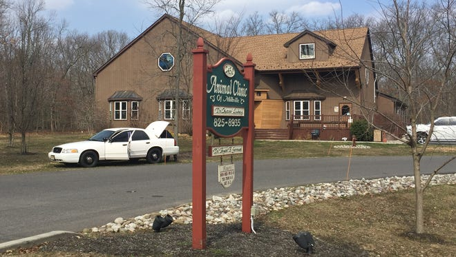 Millville police investigate a shooting incident at the Animal Clinic of Millville on Thursday.