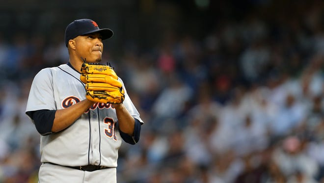 Detroit Tigers starting pitcher Alfredo Simon (31) reacts against the New York Yankees during the first inning at Yankee Stadium.