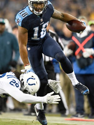 Titans wide receiver Rishard Matthews (18) goes up over Colts safety Malik Hooker (29) during the second half Oct. 16 at Nissan Stadium.