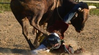Logan Harter, 15, is kicked in the back of the head after falling off his bull.