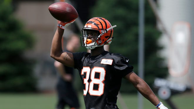 Cincinnati Bengals cornerback Darius Phillips (38) returns a ball after a play during practice in the second week of OTAs at the Cincinnati Bengals practice facility in downtown Cincinnati on Tuesday, May 29, 2018.