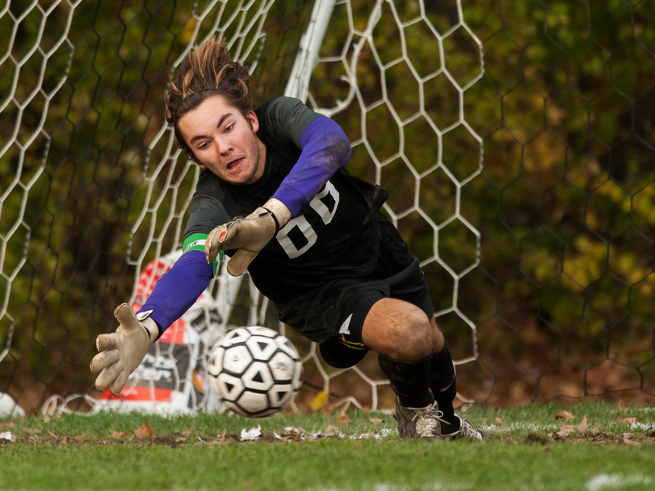 Rice goalie Leland Gazo (00) tries to makes a save on a penalty kick during the boys semi final soccer game between Green Mountain Valley and Rice at Rice high school on Tuesday afternoon October 28, 2014 in South Burlington, Vermont. (BRIAN JENKINS, for the Free Press)