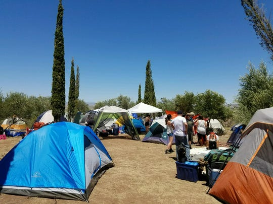 Festival-goers set up their tents for FORM Arcosanti.