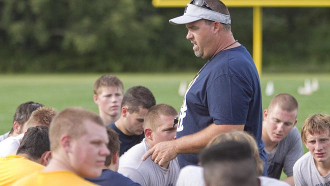 Hartland coach Brian Savage talks to his team following the first day of practices.