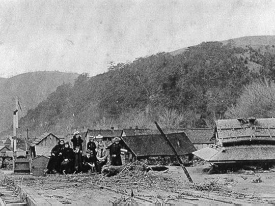 People gather near the depot shortly after the flood. The cafe owned by James Guthrie was located across from the depot.