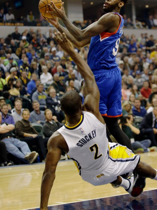 Philadelphia 76ers forward JaKarr Sampson, right, runs into Indiana Pacers guard Rodney Stuckey while shooting during the first half of an NBA basketball game in Indianapolis, Wednesday, Oct. 29, 2014. Sampson was called for a foul on the play. (AP Photo/AJ Mast)