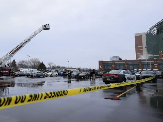 Law enforcement officials investigate an incident on