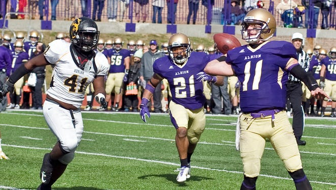 Albion College quarterback Dominic Bona (11) passed for 229 yards and one touchdown against Adrian on Saturday.